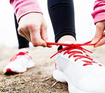 th_Women-tying-running-shoes